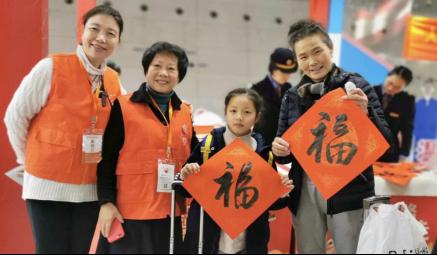 """杭州站""""小甜橙""""志愿者上线 助力春运269.png"""